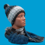 blue knitted hat with ponpon